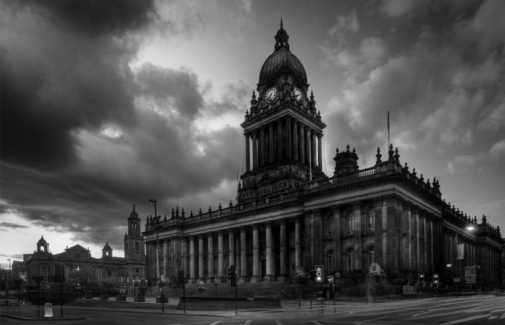 Leeds Town Hall in black and white with moody sky