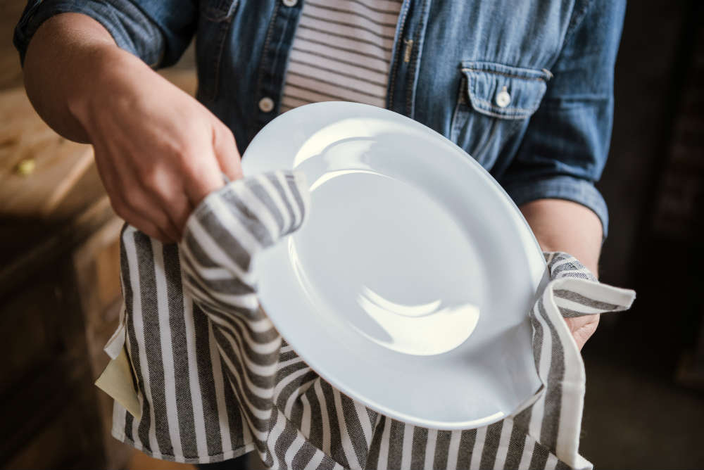washing up a plate