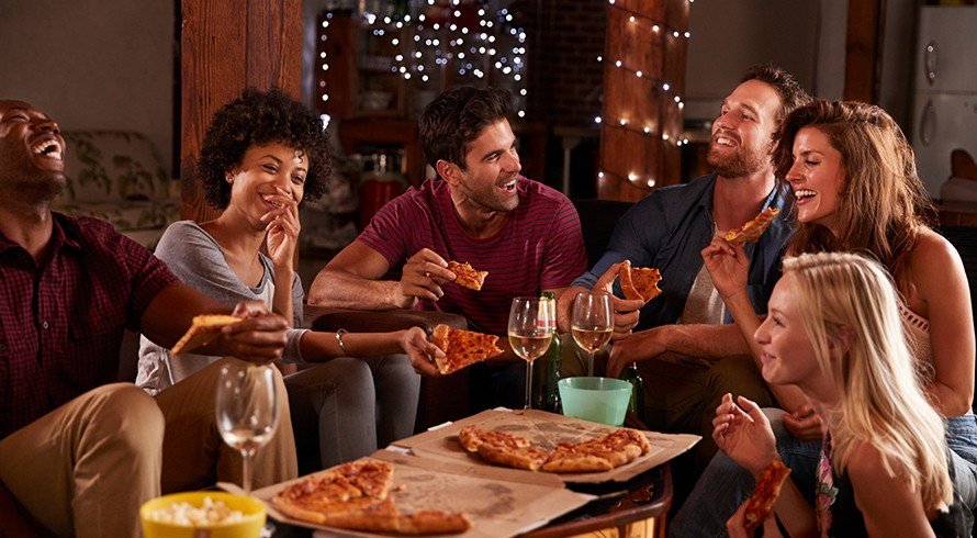 Group of people eating pizza